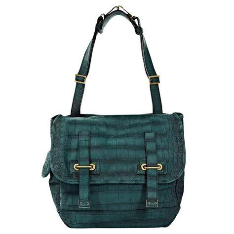 teal yves saint laurent alligator embossed leather bag  stdibs