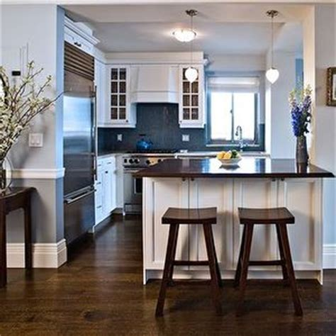 espresso cabinets turquoise walls   blue brown kitchen