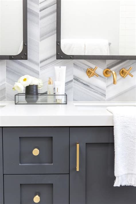 dark gray bathroom vanity  brass hardware chevron