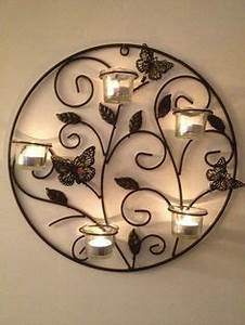 large wall sconce and candles a la maison pinterest With best brand of paint for kitchen cabinets with wrought iron wall decor candle holders
