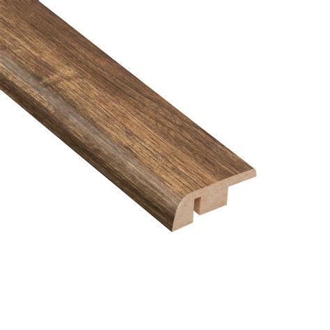 home depot flooring reducers home legend los feliz walnut 1 2 in thick x 1 1 4 in wide x 94 in length laminate carpet