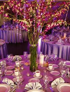 Centerpieces with purple dendrobium orchids, curly willow ...