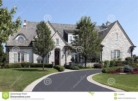 luxury stone home  circular driveway stock images