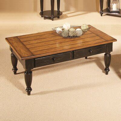 You really can't make a mistake with the upholstered table that features a serving tray on it. Country Vista Coffee Table Set | Wayfair