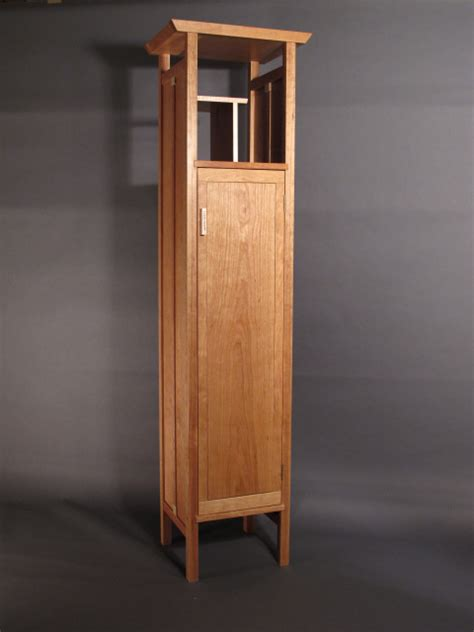 tall narrow armoire cabinet  linen closet entry