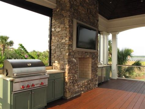 amazing covered deck patio with brick outdoor fireplace