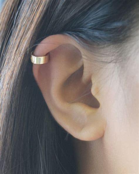 90 Helix Piercing Ideas For Your Trendiest Self. Thyroid Necklace. Heart Pendant Necklace. Wand Necklace. Renoir Copper Necklace. Black Cord Necklace. Sand Necklace. Peridot Stone Necklace. Small Layered Necklace