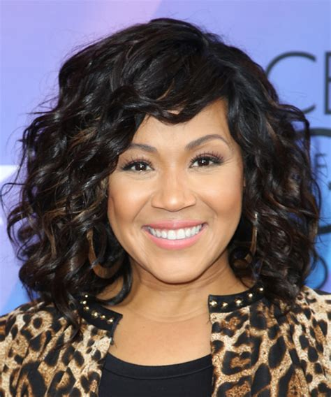 erica campbell medium curly formal hairstyle black hair