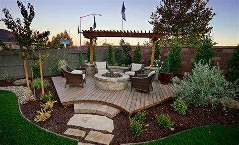 backyard corner deck with pit and landscaping