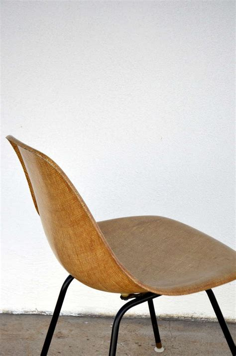 single fiberglass encasted fabric mesh chair by eames for