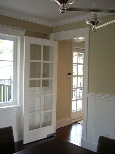 dining room waiter pivot door traditional interior