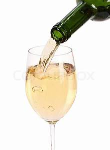 White wine being poured into a wine glass.Isolated on ...