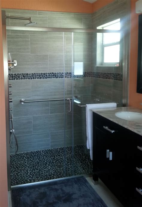 sliced black pebble tile shower floor and border subway tile outlet