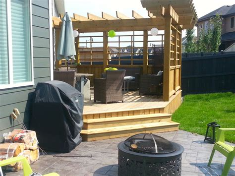 treated deck  custom privacy screen  pergola