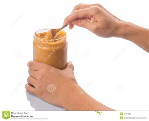 Female Hand With Peanut Butter Ii Stock Photo
