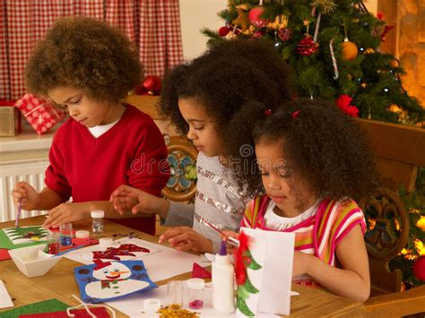 Mixed Race Children Making Christmas Cards Stock Photo