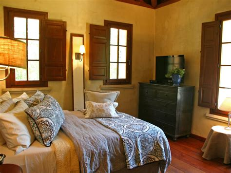 Rustic Western Bedroom With Wooden Shutters