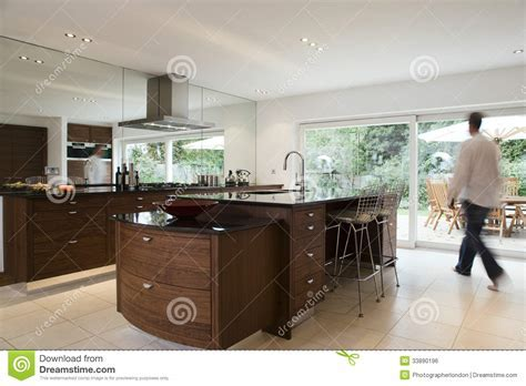 Blurred Man In Modern Kitchen Stock Photo   Image of