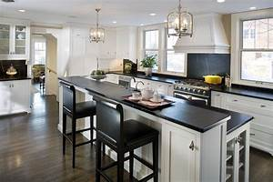 the quick 411 on soapstone countertops With kitchen colors with white cabinets with large carved wood wall art