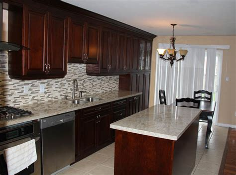 cherry coloured custom kitchen cabinets with granite