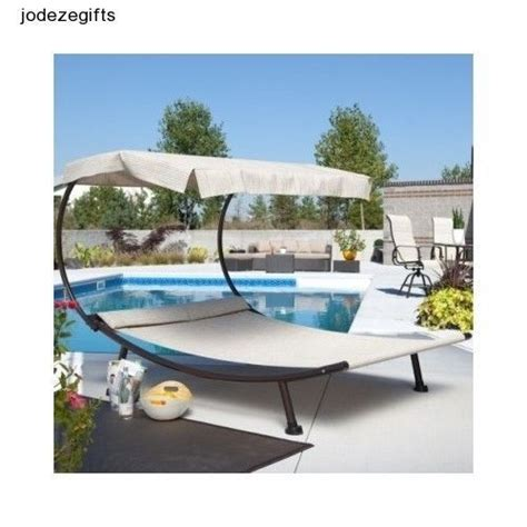 hammock with canopy chaise lounges and outdoor patios on