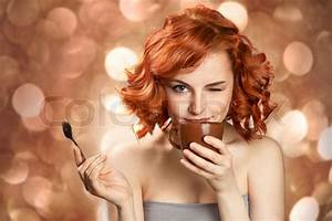 Young pretty woman drinking coffee | Stock Photo | Colourbox