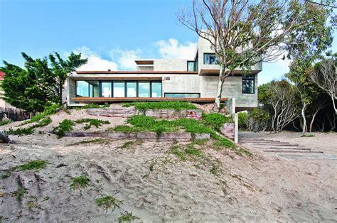 bare concrete beach house modern house designs