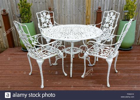 white cast iron garden table and chairs in a back garden