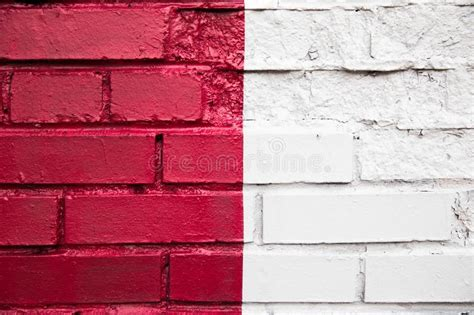 red brick wall  painted  white paint stock photo