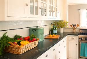 White Cabinets With Black Hardware by Carrera Marble Countertops Transitional Kitchen