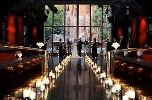 super romantic candle lined wedding aisle with waterfall With romantic las vegas wedding