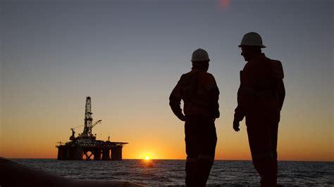 gas giants exxonmobil woodside pause exploration  oil
