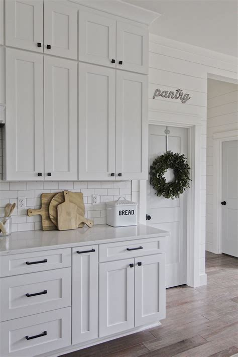 Popular white kitchen cabinets gleam with pizzazz, do you agree? Modern farmhouse kitchen, white kitchen, shaker cabinets, white cabinets, subway tile ...