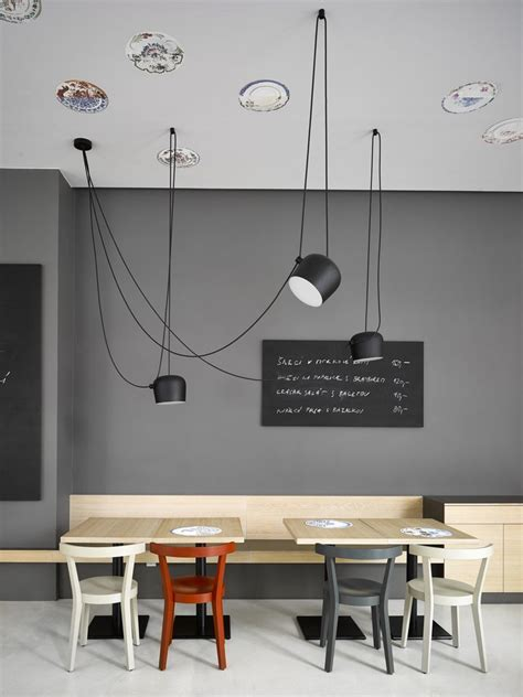 Cafe in Prague Proves Minimalist Interiors Can Be Playful