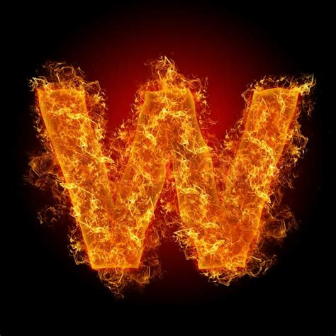 flammable home fire small letter w on a black background stock photo