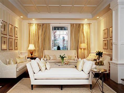 formal living room design ideas  gold curtain elegant lamps  long sofa  white pilow