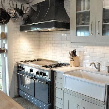 gold kitchen hood  bluestar range contemporary kitchen