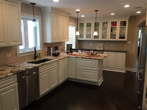 lazy susan traditional kitchen with painted white cabinets and glass