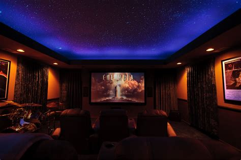 cal home theater showing sky mural and logo