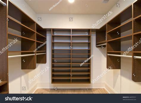 large walk in closet with modular shelves stock photo