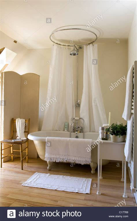 freestanding roll top bath with circular shower curtain in