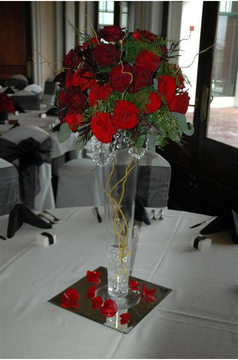 Tall Vase Centerpiece With Red Roses Instead Of The Leaves