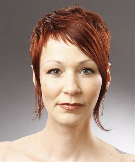 short straight alternative pixie hairstyle with side swept bangs orange hair color