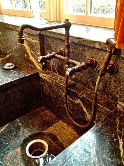 kitchen stone counters  integrated sink  wall