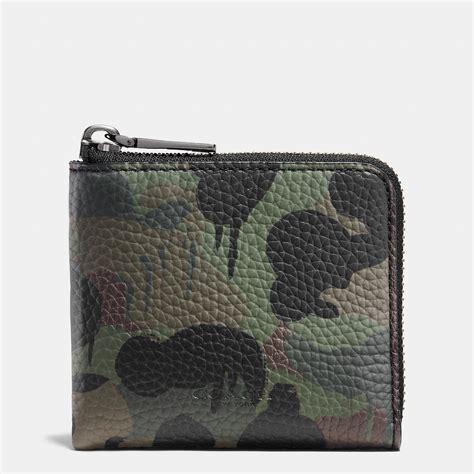 fossil motif coach half zip wallet in beast camo print pebble