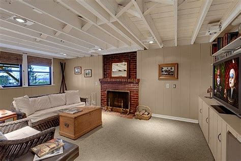 Exposed Basement Ceiling Lighting Ideas by Basement Exposed Painted Ceiling Either White Or Black