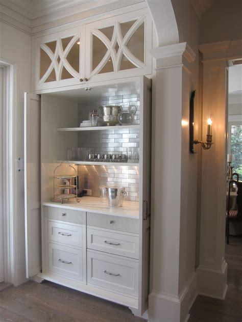 beautiful custom dry bar area  recessed pocket doors