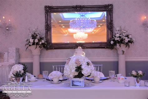 The bride and groom table is decorated for the reception