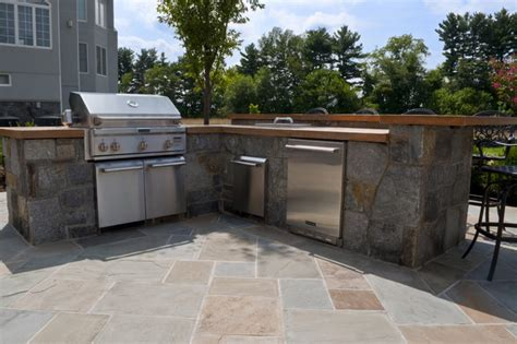 based outdoor kitchen with concrete countertops