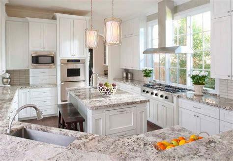 Giallo Ornamental Granite With White Cabinets Giallo